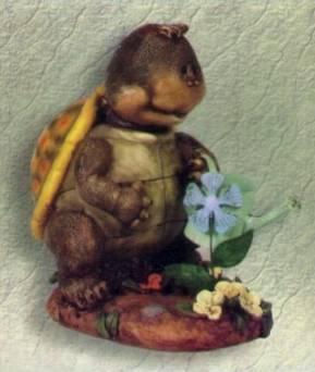 Schildkröte mit Gießkanne